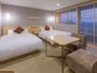 ゆったりと寛げる畳のお部屋に、ベッドをを配置したゆとりのあるツインルームです。