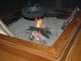 信州名物「おやき」中でも原点の灰焼おやきを造っている囲炉裏