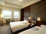 【客室の一例】余裕のある広さを確保した、ベッドルーム。心地よい眠りをお届けします。