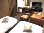 デラックスツインルーム、6階(最上階)の海側、禁煙室羽毛布団、シャワートイレ完備