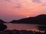 屋上展望露天風呂から望むおしどりの池に映える夕日