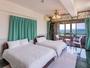 オーシャンビュー4LDK(洋室)130平米 定員7名のベッドルームのひとつ