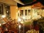 【源泉大浴場】 男性大浴場「万万の湯」光の演出が施された露天部分は独特の雰囲気(露天風呂イメージ)